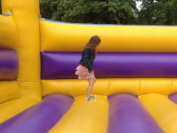 girl bouncing in an inflatable bounce castle