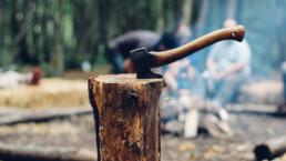 hatchet buried into a stump