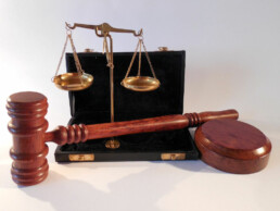 gavel, justice scales, and briefcase