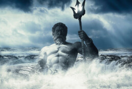 bust of Poseidon rising out of a foamy sea holding a trident